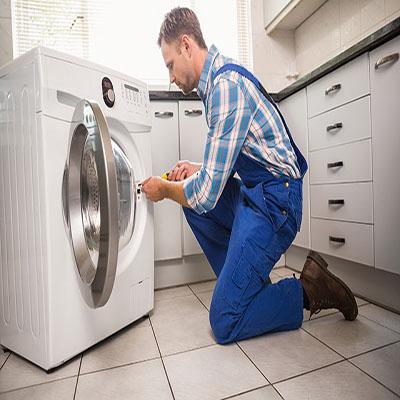 washing machine 2 Handyman fixing a washing machine